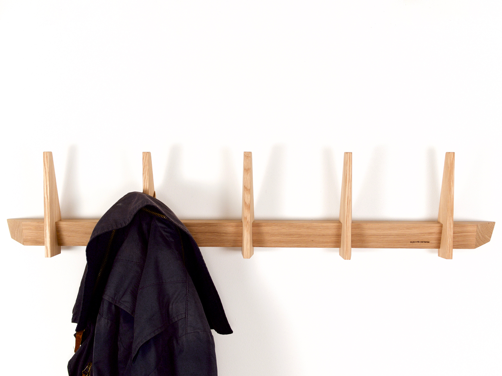 Simple coat racks made in oak wood from Hjuler.Design Danish modern scandinavian design